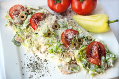 A small Caesar Salad with shredded parmesan cheese, croutons and Stock Image
