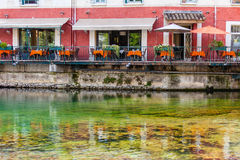 Small cafe on a quay in a french town Royalty Free Stock Photos