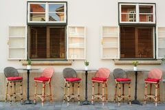 Small cafe tables and chairs in old city stock photos