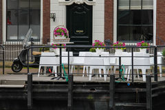 Small cafe on the waterfront near Spaarne river in Haarlem Stock Photo