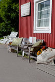 Small café on the swedish island of käringön. A couple of chairs and a menu is visable on the outside Royalty Free Stock Photo