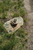 Small cairn erected as trail marker on highlands. Close-up of small cairn, a human-made rock pile erected as trail marker or landmark on highlands at the Serra stock photos