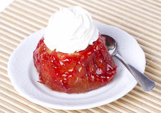 Small cake with cherry glaze and cream Stock Image