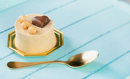 Small cake with hazelnuts and chocolate heart. Royalty Free Stock Photos