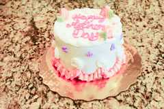 Small cake. Mini cake with pink letter Royalty Free Stock Images
