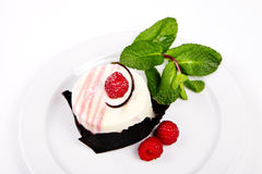 Small cake with rasberry and mint Royalty Free Stock Photos