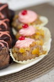 Small cakes with cherry. On the plate Royalty Free Stock Photo