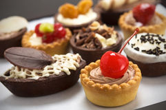 Small cakes with different stuffing Royalty Free Stock Photography