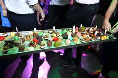 Small cakes on a large tray - an unusual way to serve dessert at a wedding.  stock images