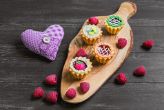 Small cakes petit fours Royalty Free Stock Photos
