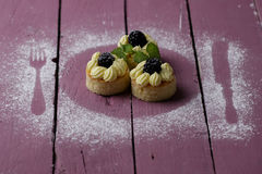 Small cakes on the pink wood table Royalty Free Stock Photography