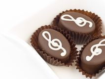 Small cakes with violin key. Close up of small cakes Stock Photography
