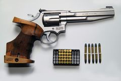 Small caliber Smith and Wesson revolver sports weapon with associated ammunition Royalty Free Stock Image