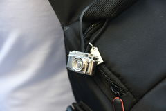 Small camera in the bag. Nice and small camera in the bag Royalty Free Stock Photos