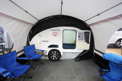 Small camper Caretta with awning Stock Photo