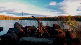 Small campfire burning at camp in the Adirondack Mountains. Black River Wilderness stock video footage