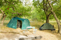 A small campground in oak forest Stock Photos