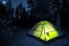 Small Camping Tent. Illuminated Inside. Night Hours Campsite royalty free stock photos