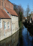 Small canal in Brugge. View of historic buildings along the canal in Brugge, Belgium Royalty Free Stock Photography