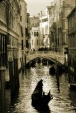 Small canal and gondola among the houses in Venice. Italy (sepia toned Royalty Free Stock Photos