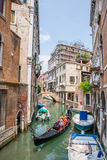 Small canal with gondola in Venice, Italy. Stock Photography