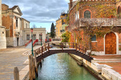 Small canal and house. Venice, Italy. Royalty Free Stock Image