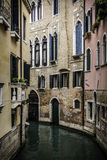 Small Canal among houses in Venice Stock Photography