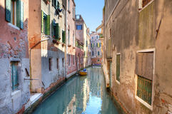 Small canal among houses. Venice, Italy. Royalty Free Stock Photos