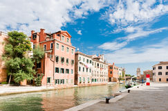 Small canal iwith colorful buildings n the Venice Stock Image
