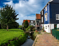 Small canal of Marken and nicely painted houses Stock Photo