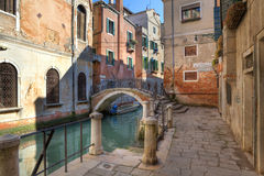 Small canal and old house in Venice, Italy. Stock Photos