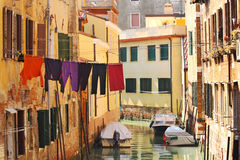 Small canal among old houses in Venice, Italy. Stock Images