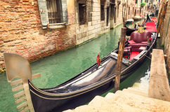 Small canal with parked gondola in Venice, Italy Royalty Free Stock Photography