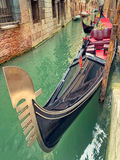 Small canal with parked gondola in Venice, Italy Royalty Free Stock Image