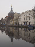 Small canal with reflection of the Marekerk church in the water Stock Photo