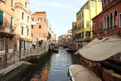Small canal with romantic bridge in venecia Royalty Free Stock Photo