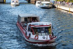 Small canal tour boat on river Spree. Berlin Germany - April 21. 2018: Small canal tour boat on river Spree stock images