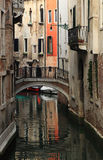 Small canal in Venice. Between old buildings Stock Photography