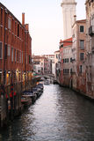 Small canal in Venice. The Grand Canal of Venice and buildings. Gondolas, boats and small boats all day crossing from one coast to another Stock Photos