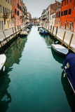Small Canal in Venice, Italy. A small canal in Venice, Italy Royalty Free Stock Photo