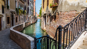 A small canal in Venice. Romantic narrow canal in Venice, Italy Stock Image