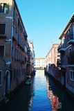 Small canal in Venice. Ruis, medieval walls, boat and architecture along a small canal, in Venice, Italy, Europe. For more photos see the collection Venice Royalty Free Stock Photos
