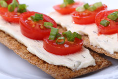 Small canape with tomato and onion Stock Photography