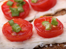 Small canape with tomato and onion Royalty Free Stock Images