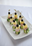 Small canapes with ham on a skewer Stock Images
