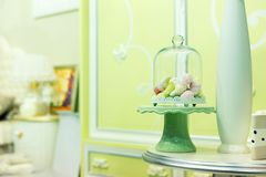 Small candies in room interior Royalty Free Stock Photo