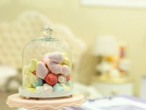 Small candies in room interior Stock Photo