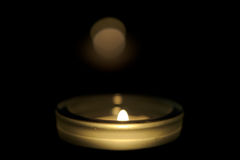Small candle burning in the dark Stock Photos