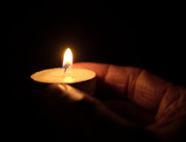 Small candle light in a hand Stock Photography