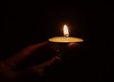 Small candle light in a hand Royalty Free Stock Photography